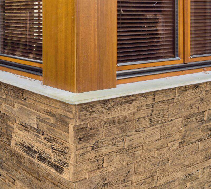 Häusler Verkleidungsplatte aus versteinertem Holz